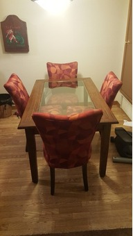 Wooden and Glass Dining Room Table with Four Upholstered Chairs